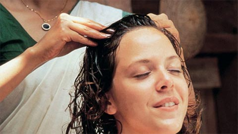 Hot oil massage for hair care and hair loss
